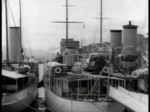 driving past docked boats in harbor. large harbor w/ docked boats. . large multiple storied building near water. - 1935 stock videos & royalty-free footage