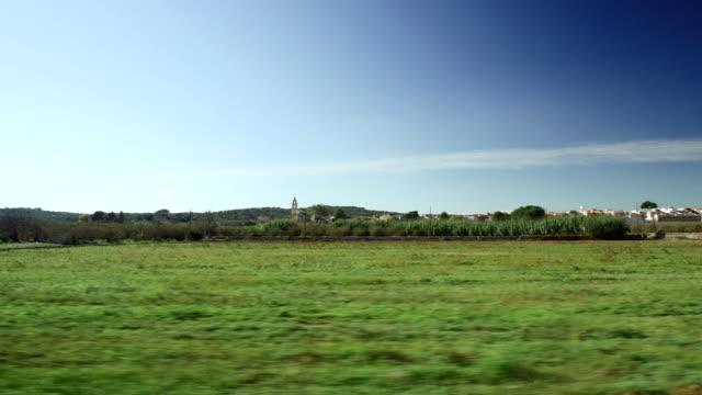 POV driving past fields