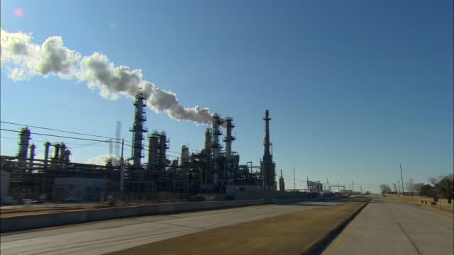 POV Driving past large refinery complex, Ponca City, Oklahoma, USA