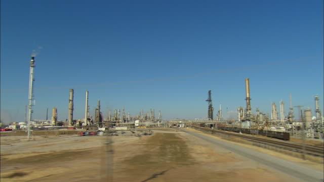 SIDE POV Driving past large refinery complex, Ponca City, Oklahoma, USA