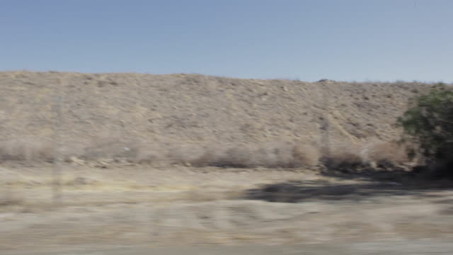 pov driving past rocky field / santa clarita, california, united states - santa clarita stock videos & royalty-free footage