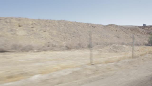 pov driving past santa clarita mountains / california, united states - santa clarita stock videos & royalty-free footage