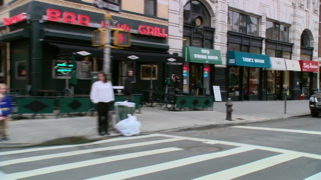 ws driving past storefronts, pedestrians and parked cars - butiksskylt bildbanksvideor och videomaterial från bakom kulisserna