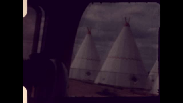 driving past teepees on the way to the grand canyon - mesa verde nationalpark stock-videos und b-roll-filmmaterial