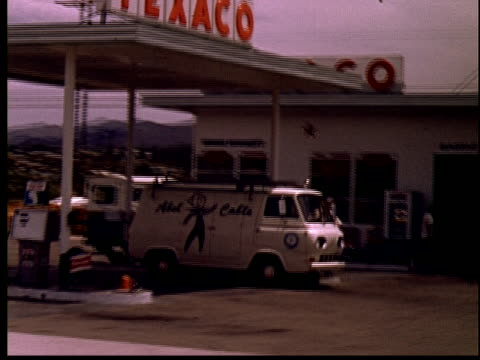 1965 ws car pov driving past texaco gas station/ yucca valley, california - fuel pump stock videos & royalty-free footage