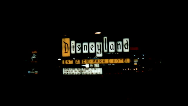 driving past the disneyland entrance sign in the late 1960s. - entrance sign stock videos & royalty-free footage