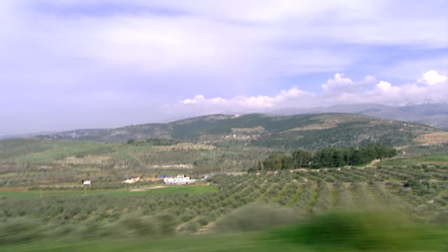driving plate through the scenery of the marjeyoun district of southern lebanon with a view of agricultural lands and the foothills of mount hermon - foothills stock videos & royalty-free footage