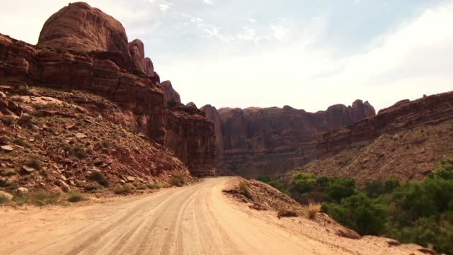 driving point of view in moab - 4x4 stock videos & royalty-free footage