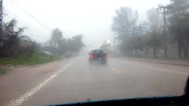 Driving point of view in torrential rain storm