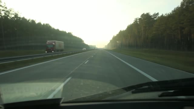 vidéos et rushes de driving point of view through car windscreen as drives along an emtpy stretch of the a2 highway linking berlin and warsaw near torzym poland on... - car point of view