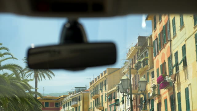 Driving pov in a luxury resort town in Italy, Europe. - Slow Motion