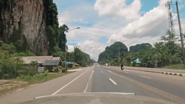 driving process plates front view phet kasem road mountain range, highway 4, krabi town, thailand - southeast asia stock videos & royalty-free footage