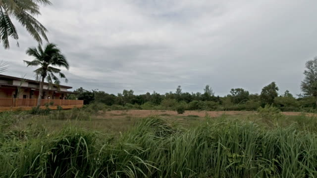 driving process plates in rural thailand rainy season side view - passenger point of view stock videos & royalty-free footage