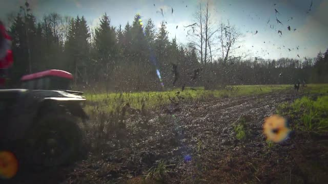 driving quad through mud - kopfbedeckung stock-videos und b-roll-filmmaterial