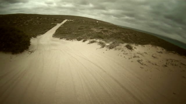 hd time lapse: driving quadbike - vignette stock videos & royalty-free footage
