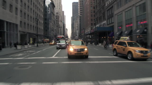 driving reverse pov of 5th avenue from 43th to 40th st on a grey day.  traffic creaps on 5th ave - fifth avenue stock videos & royalty-free footage