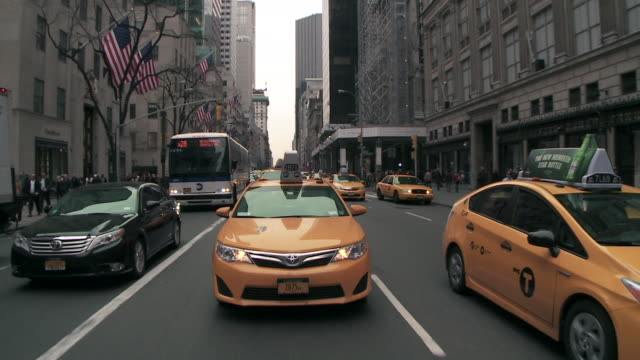 Driving Reverse POV of 5th avenue from 51th to 46th St on a grey day.  Traffic creaps on 5th Ave