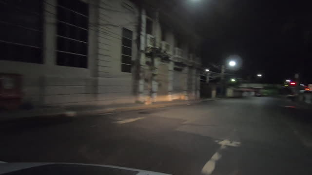 pov driving shot at night through the deserted streets of san salvador due to the gang crime that exisits there - point of view stock videos & royalty-free footage