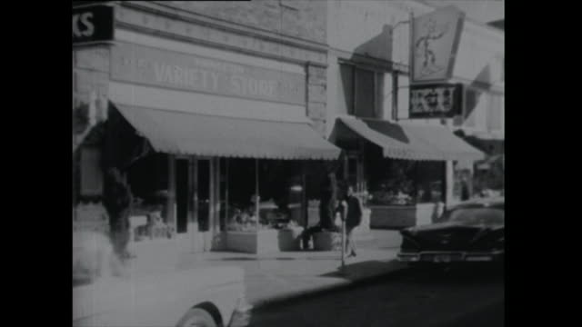 pov driving shot down small town street - 1961 stock videos & royalty-free footage