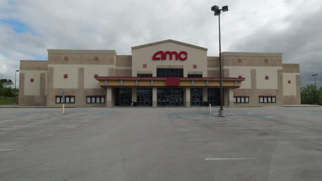 driving shot of amc movie theater's empty parking lot amid 2020 global coronavirus pandemic in north georgia, usa - street light stock videos & royalty-free footage