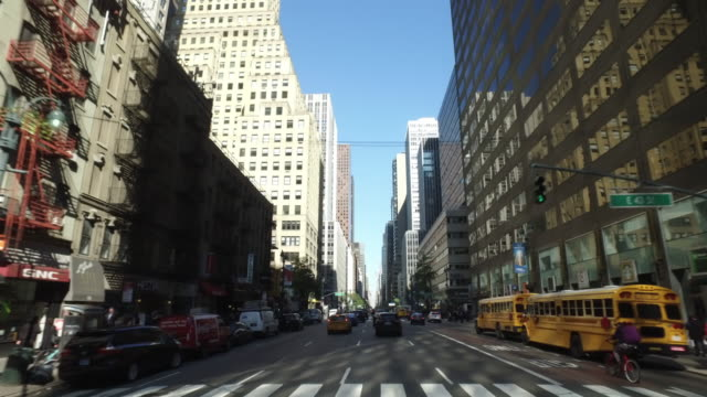 Driving shot of buildings and traffic in New York City