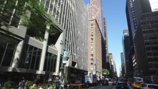 driving shot of buildings and traffic in new york city - pedestrian stock videos & royalty-free footage