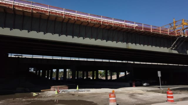 driving shot of highway road and bridge construction in orlando, florida - bridge built structure stock videos & royalty-free footage