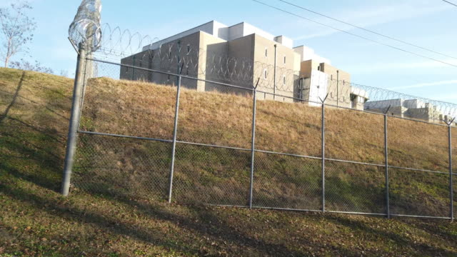 driving shot of jail fence - prison fence stock videos & royalty-free footage