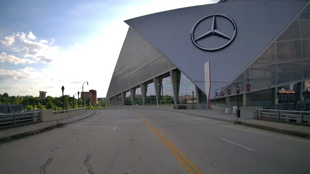 driving shot of mercedes-benz stadium in atlanta, georgia, usa at sunset on may 30, 2021. - pursuit concept stock videos & royalty-free footage