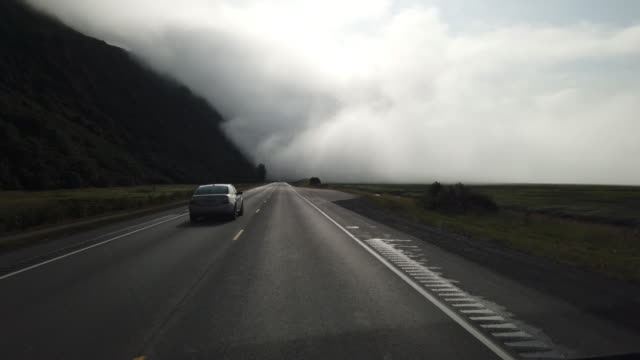 driving shot of morning driving into low clouds in the mountain area - pursuit concept stock videos & royalty-free footage