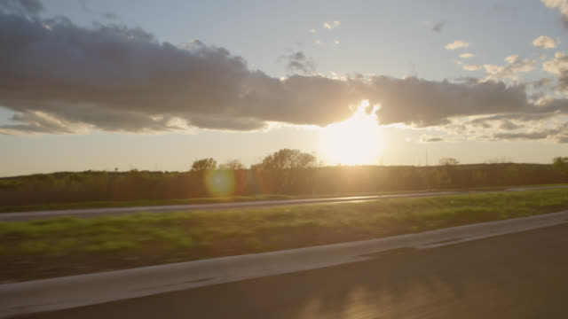 Driving shot of sun setting over Texas highway