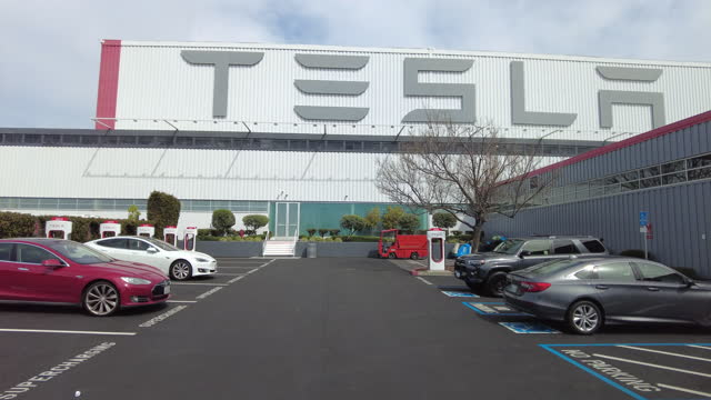 driving shot of tesla parking lot in palo alto, california on march 22, 2021. - logo stock videos & royalty-free footage