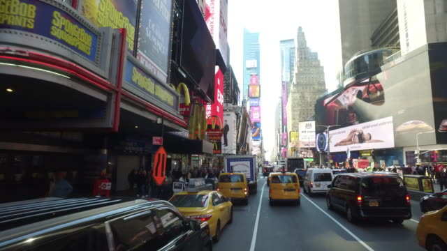 driving shot of times square, new york city - mcdonald's stock videos and b-roll footage