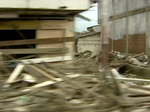 driving shots of devastation caused by tsunami in aceh province, indonesia - 2004 stock-videos und b-roll-filmmaterial