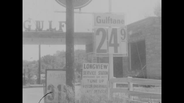 driving shots of gasoline stations prices in nashville tennessee petrol gas station rising cost of fuel - インフレ点の映像素材/bロール