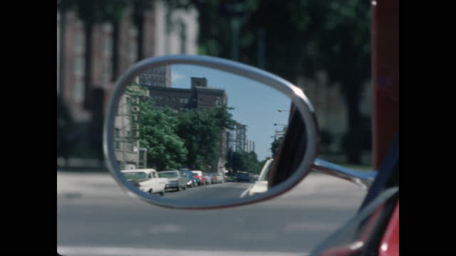 driving pov, side view mirror reflecting street scene - following stock videos & royalty-free footage