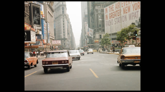1962 driving south through times square, 3 of 5 - ladenschild stock-videos und b-roll-filmmaterial