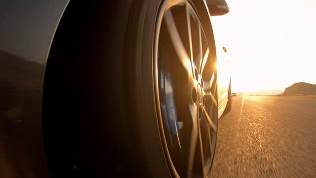 driving sports car on a race track at sunset - accelerator pedal stock videos & royalty-free footage