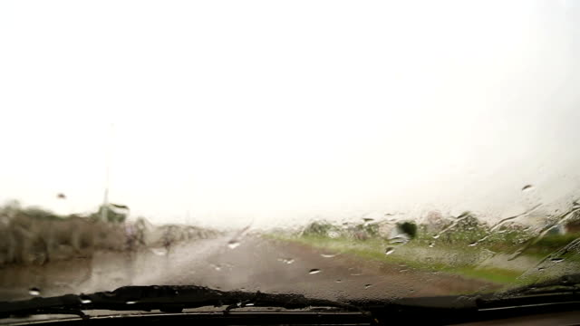 driving the car on highway during rainy season - saving up for a rainy day stock videos and b-roll footage