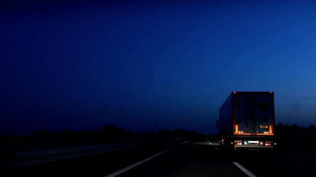 driving the highway at night - heavy goods vehicle stock videos & royalty-free footage