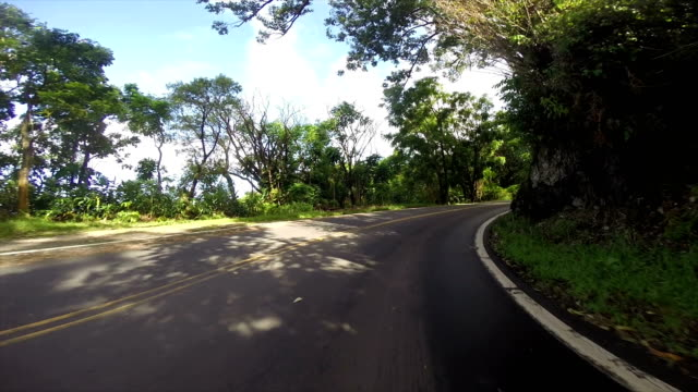 driving the roads in the islands of hawaii - winding road stock videos & royalty-free footage