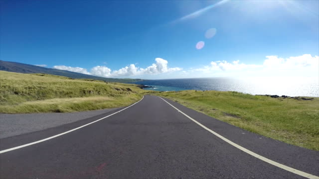 driving the roads in the islands of hawaii - road trip stock videos & royalty-free footage
