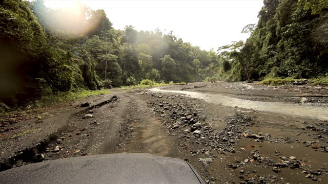 4x4 driving through a costa rican remote rainforest: muddy road - dirt track stock videos & royalty-free footage