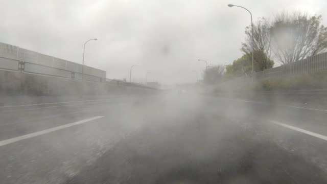 driving through a rainy highway / rear view - rear view stock videos & royalty-free footage