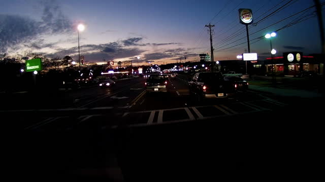 driving through a retail place in the suburb of atlanta at night in the winter of 2020 amid the global coronavirus pandemic. - dramatic sky stock videos & royalty-free footage