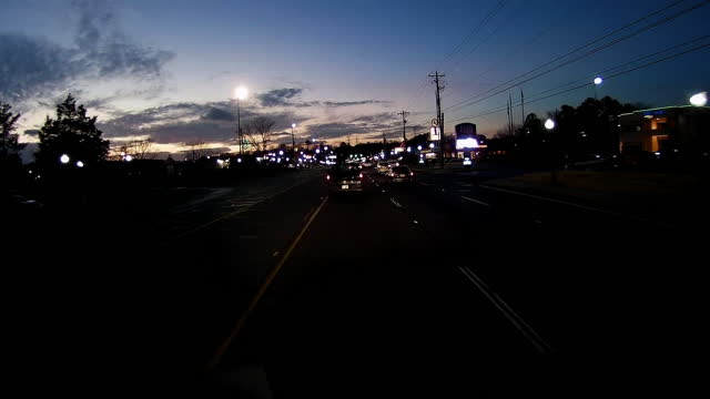 driving through a retail place in the suburb of atlanta at night in the winter of 2020 amid the global coronavirus pandemic. - tranquil scene stock videos & royalty-free footage