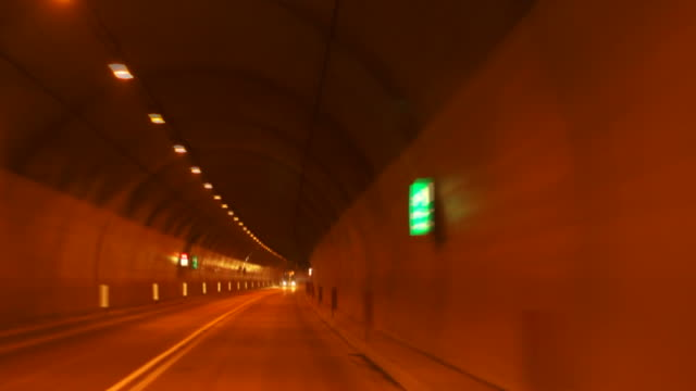 hd driving through alpine road tunnels tl - geschwindigkeit stock videos & royalty-free footage