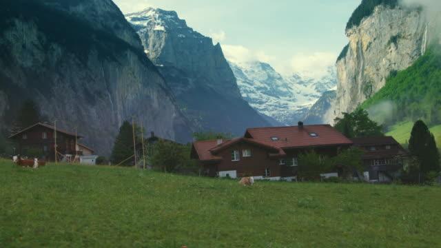 SIDE POV, Driving through Alpine village, Lauterbrunnen Valley, Bern, Switzerland