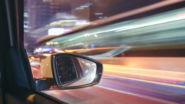 vídeos y material grabado en eventos de stock de t/l ws td pov conducir a través de la calle urbana de beijing en la noche - retrovisor exterior