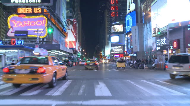 pov driving through broadway's thoroughfare of brightly lit signs, storefronts and bustling nightlife / new york city, new york, united states - broadway manhattan stock-videos und b-roll-filmmaterial